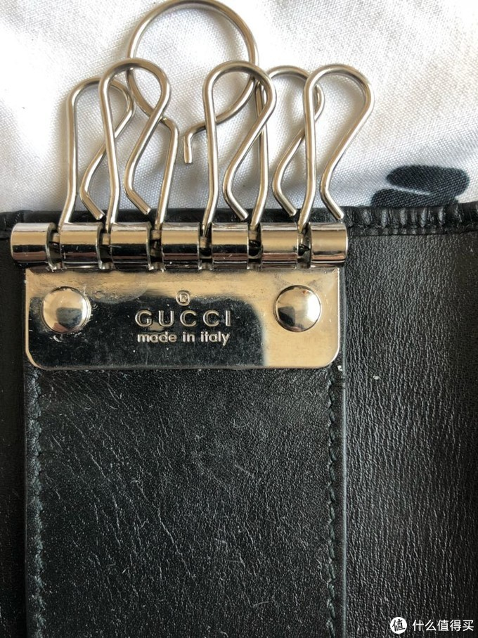 Gucci、coach钥匙包对比向