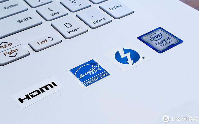 其实标识为贴纸,贴在键盘旁边