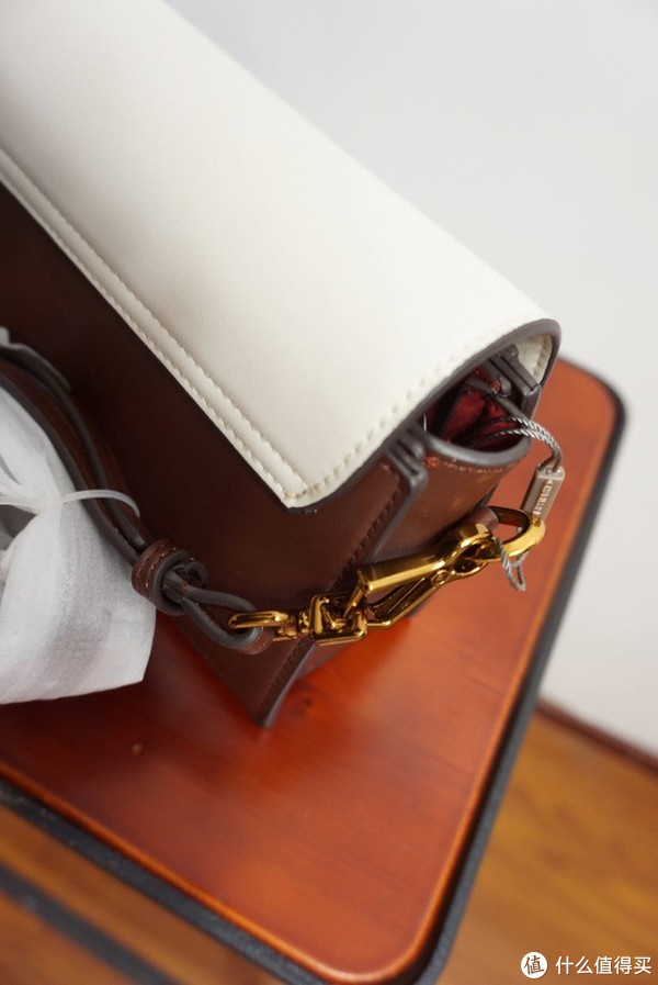 小ck棕白拼接包金属装饰
