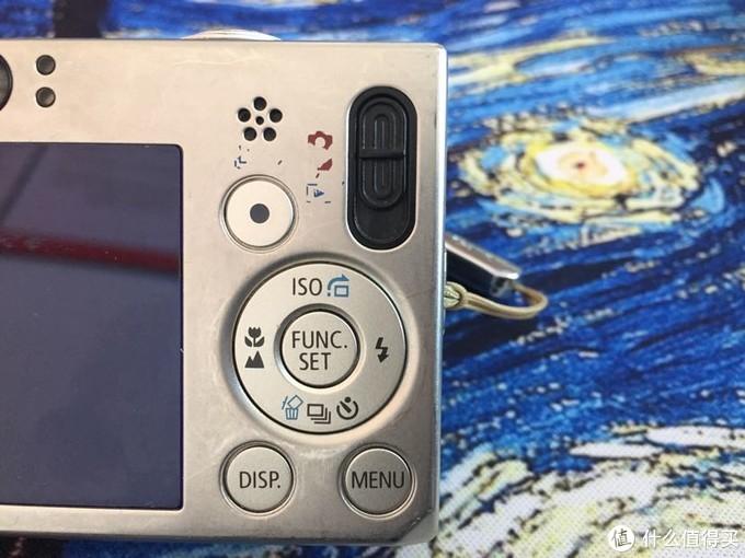 黑色的塑料拨片拨到中间就是动态影像拍摄啦