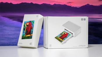 米家照片打印机外观展示(相纸盒 适配器 电源键 散热孔 指示灯)