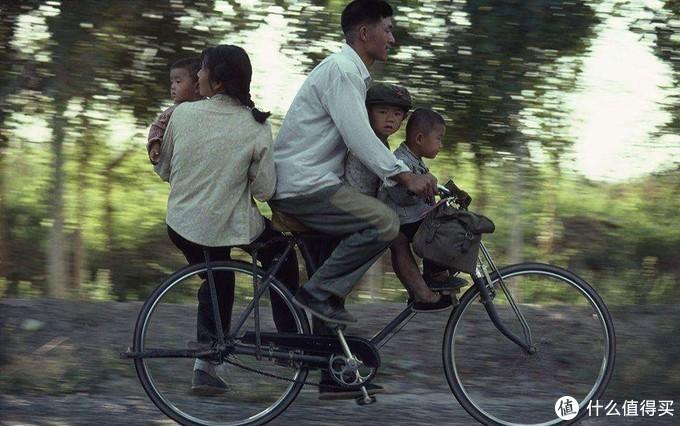 因为承重好,当时一个自行车拉一家人那是常事