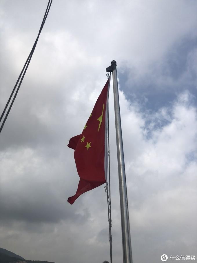 这个时候看到五星红旗很自豪