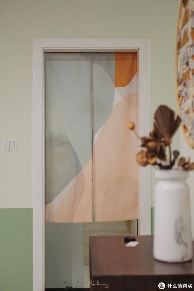 拆除木门后增加了门帘