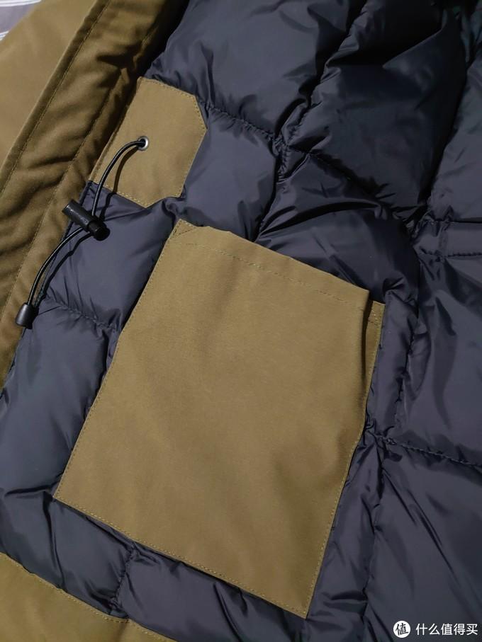 下摆内侧有个兜,可以放钱包手机。