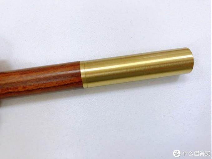 木+铜,有点像金箍棒