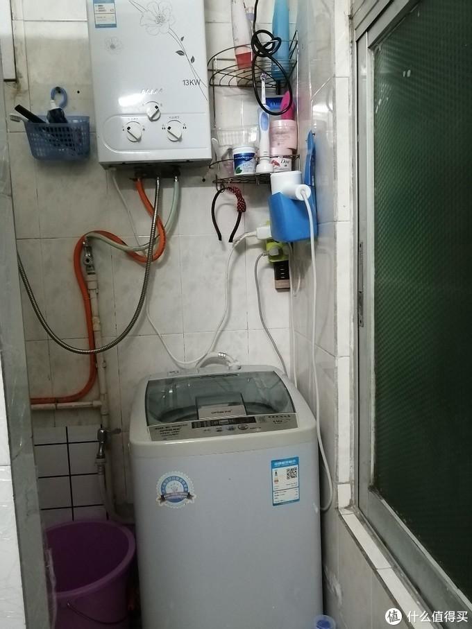 洗衣机上放冲凉的替换衣服