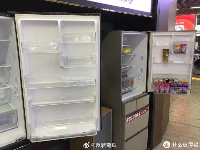 由于超薄尺寸,411冷藏室门上了饮料收纳架只有单排
