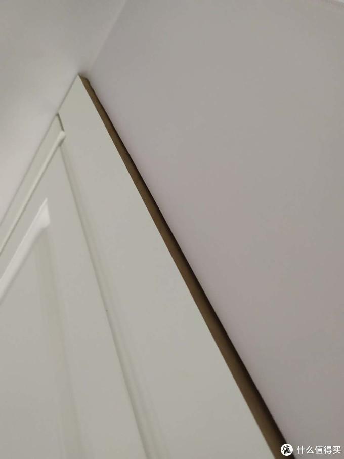 墙面不平整,柜体不贴合