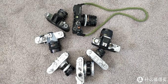 三台单反,三台旁轴,一台X-Pro2,猜猜都是什么相机、镜头?